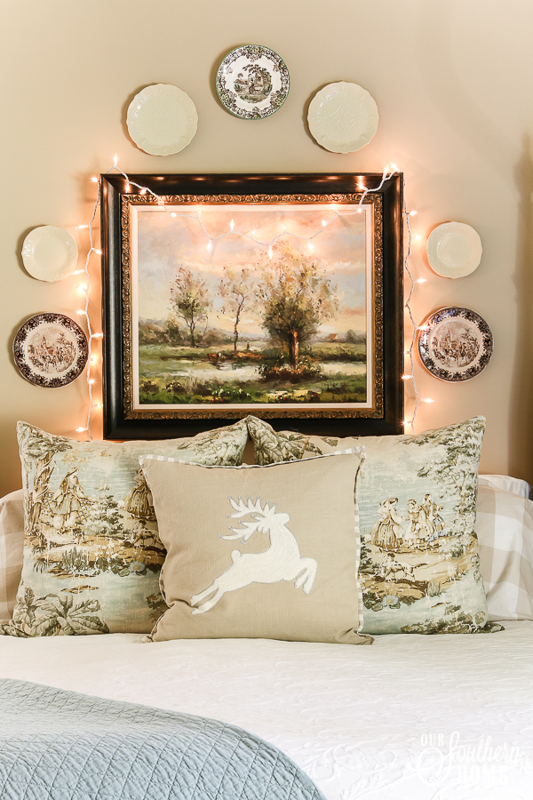 Romantic master bedroom decked for Christmas with neutral decor for an unexpected look! #christmasbedroom #christmasdecor #christmas