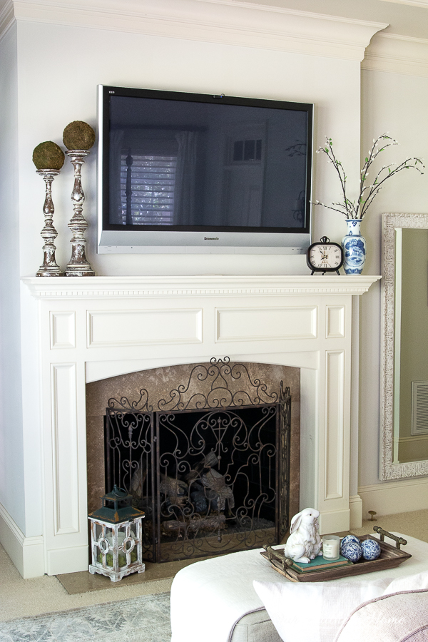 fireplace with TV in master bedroom