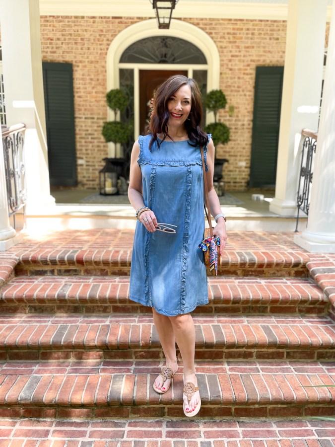 lady in a blue dress on steps