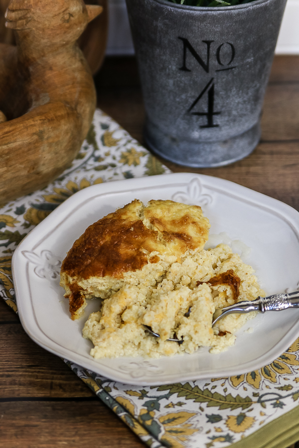Make ahead cheese grits are perfect for a holiday morning! #cheesegrits #recipe #grits #makeaheadbreakfast #breakfast #christmasmorningbreakfast #holidaybreakfast
