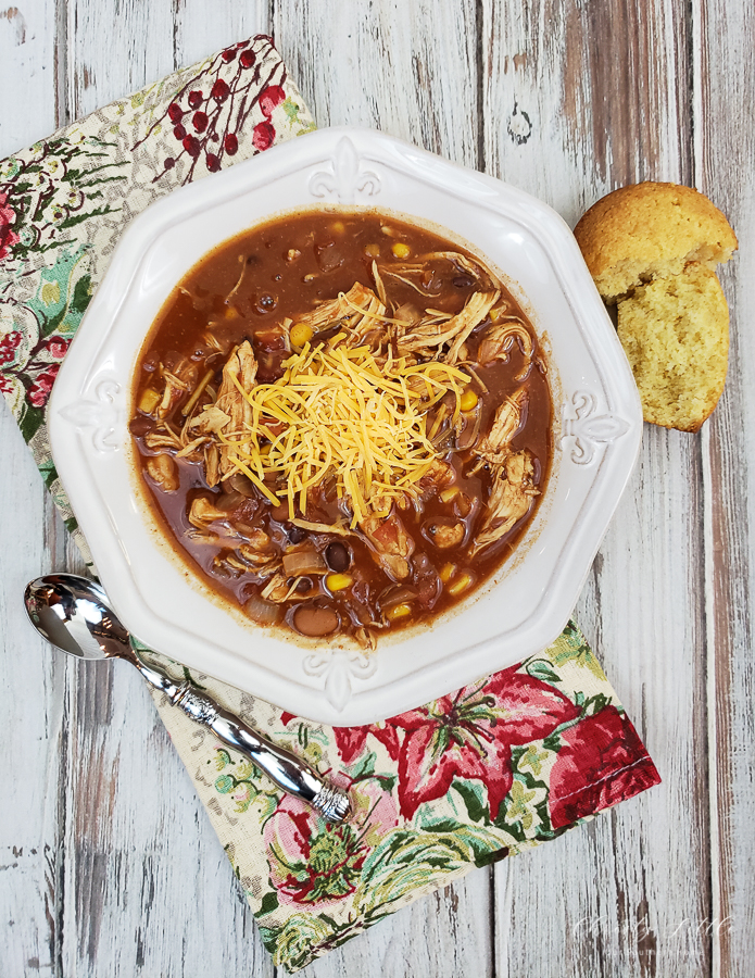 Chicken taco soup recipe perfect for a crowd! Throw the ingredients together in a slow cooker and forget it as it cooks all day.