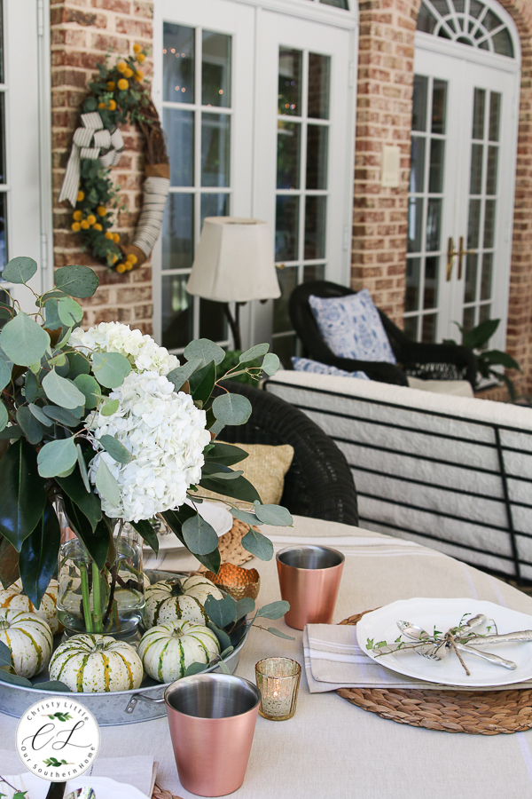 porch table decorated for fall