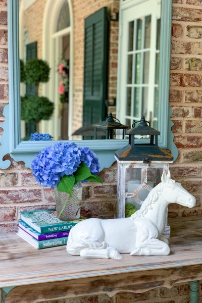 horse statue with flowers and mirror