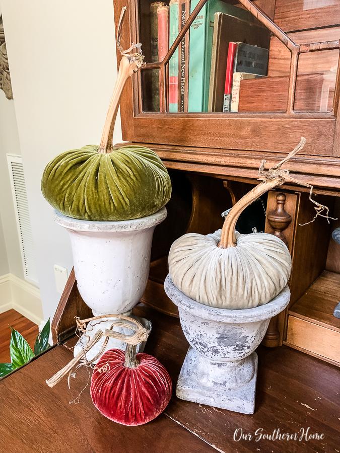 urns with velvet pumpkins