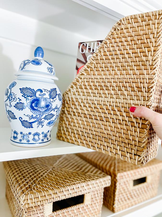 blue and white vase with magazine organizer
