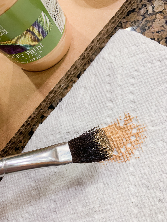 gold paint on a brush