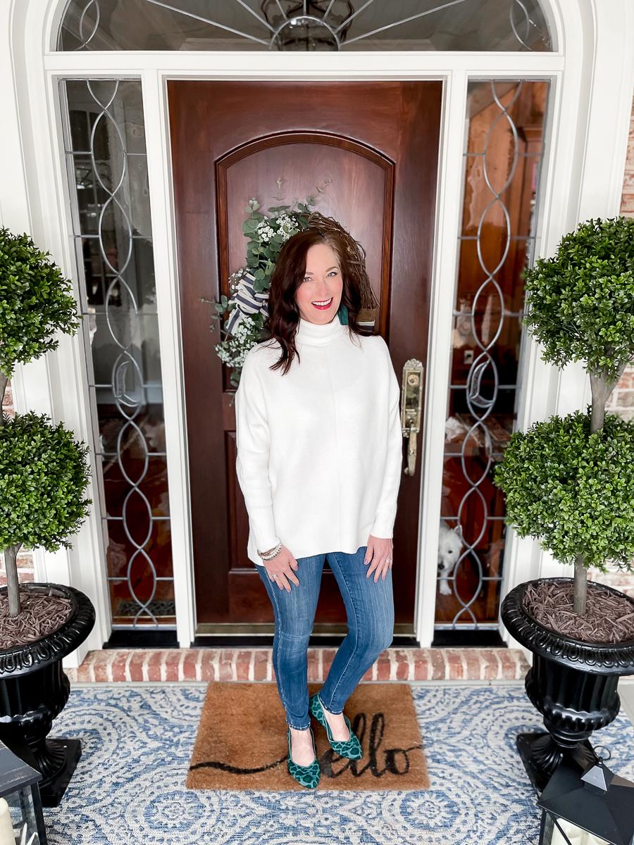 woman standing at front door