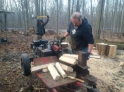 Chris and Earl splitting wood