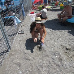 collecting sand at Amalfi Beach