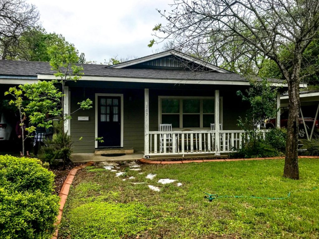 A dark green rental house with a futon yard for a weekend in Fredericksburg, Texas.