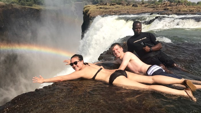 Enjoying one of the most thrilling adventuresof our lives by swimming on the edge of Victoria Falls' Devils Pool.