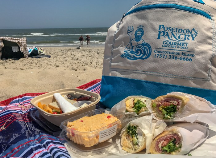 Enjoying a picnic from Poseidon's Pantry is one of the best things to do in Chincoteague!