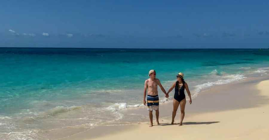 Strolling through one of Bermuda's best kept secret beaches. It is a private beach located at he Reefs Resort & Club.