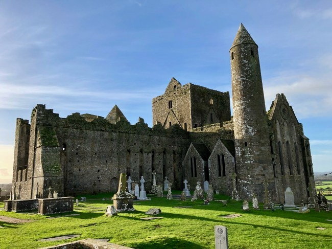 Rock of Cashel sits majestically above the city, Cashel, Ireland. It is a stunning fortress full of history dating back to the 12th century. Though it is still standing tall, the fortress is exactly what you would imagine when thinking of a medieval fortress in ruins.