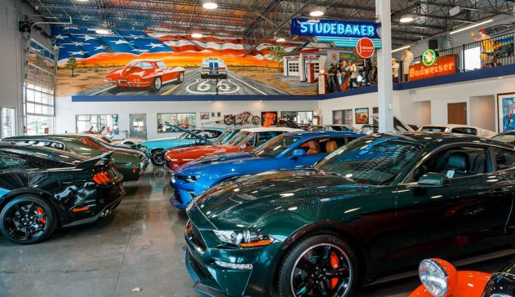 A visit to Fast Lane Classic Car is one of the best things to do in St. Charles because you can see several cars in three different showcase rooms. Here is one showcase room with different classic cars lined up.