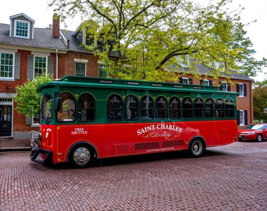 A red and green trolley in St. Charles on Main Street.