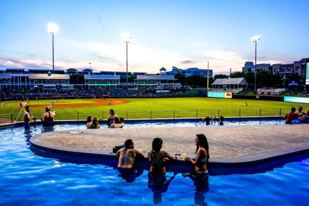 A bunch of people hanging out in the Choctaw Lazy River at the RoughRiders baseball game which is one of the best things to do in Frisco.