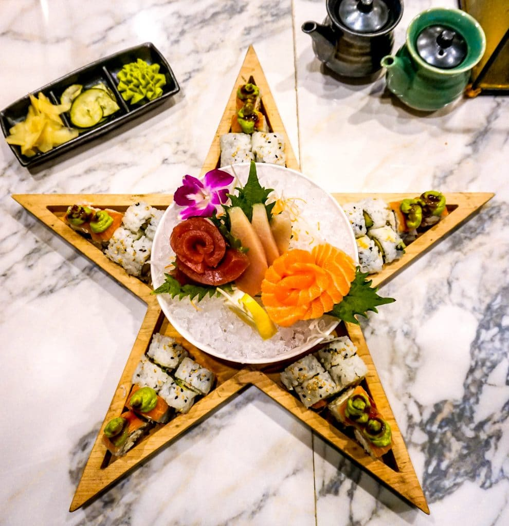 Several different sushi inside a wooden star with a bowl of sashimi in the middle from the best sushi restaurant in Frisco - Sushi Marquee