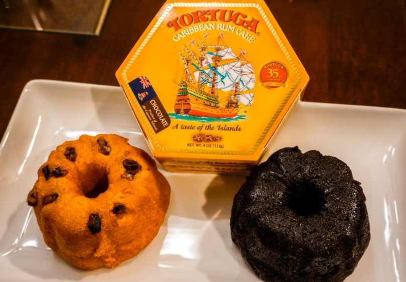 Two Tortuga Rum Cakes - left is original and the right is chocolate. In the top middle is a yellow box that says Tortuga Rum Cake.