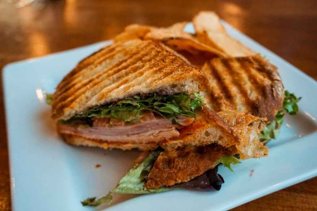 A delicious looking Italian pesto panini from Grape Creek Vineyards stacked on top of each other.