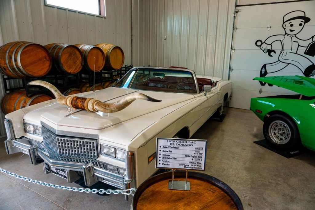 A white cadillac with longhorn in the front.