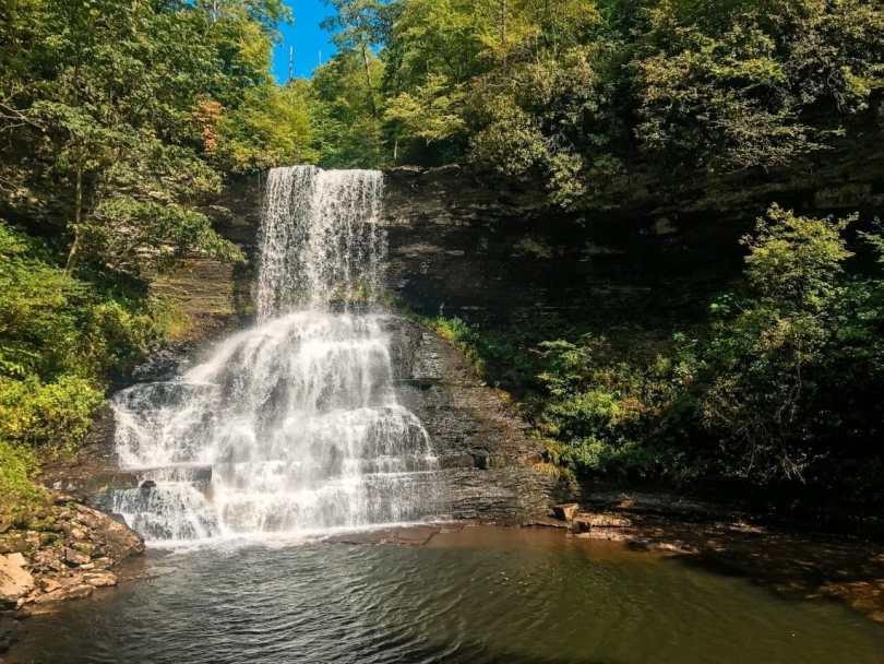 A 69 ft. waterfall cascading down rocks and into a natural swimming pool. This park is called Cascade Falls and is a great place to go hiking near DC.
