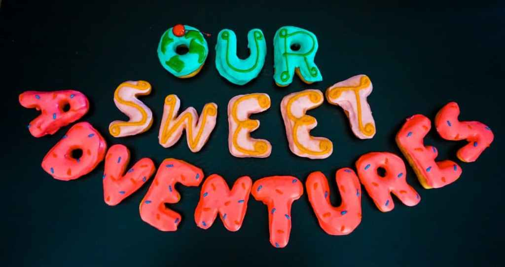 """Donuts that spell out """"Our Sweet Adventures""""."""