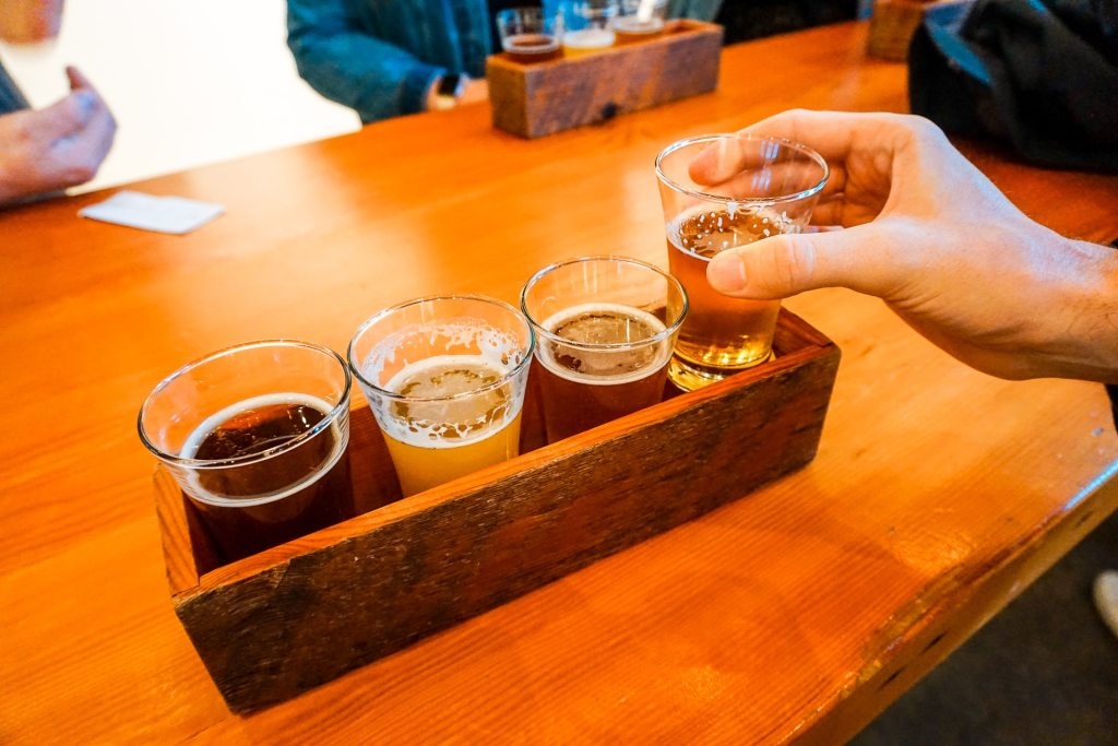 A beer flight of different types of local craft beer in Vancouver.