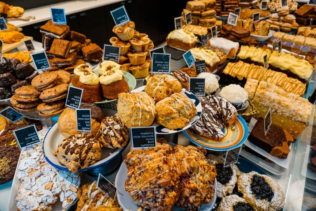 A wonderful display case of freshly baked pastries from Pure Bread - one of the best places to eat in Vancouver for sweet treats and baked goodies.