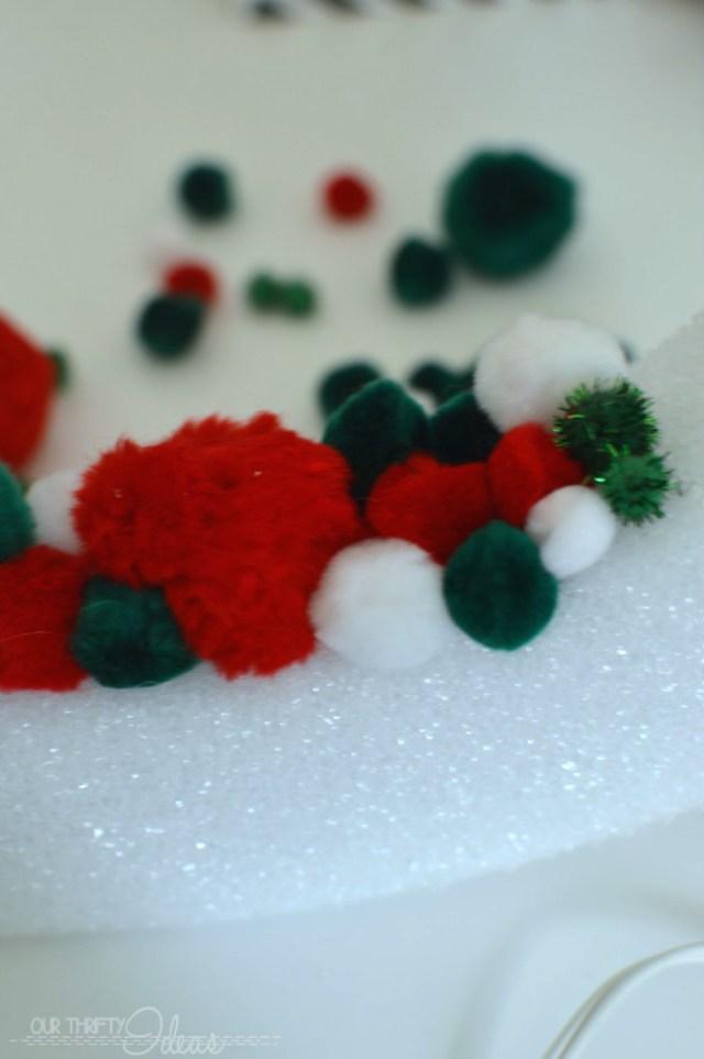 Using Pom Poms to create a Christmas Wreath
