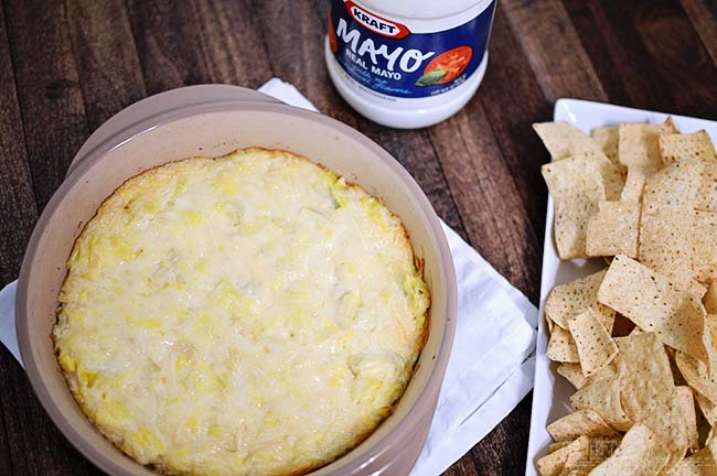 A simple and easy Hot Artichoke Dip recipe that goes together in minutes.