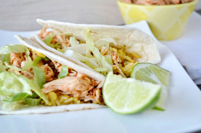 Make these amazing tacos by cooking the chicken in the crockpot with salsa. It will fall apart  so easily and is SO good.