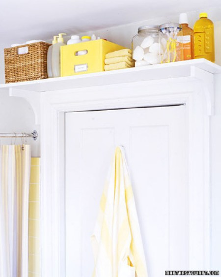 Add a shelf above your bathroom door for all the things you don't use often