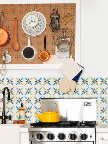 Use a pegboard to hang your kitchen accessories. It's not only convenient, but can act as decor too