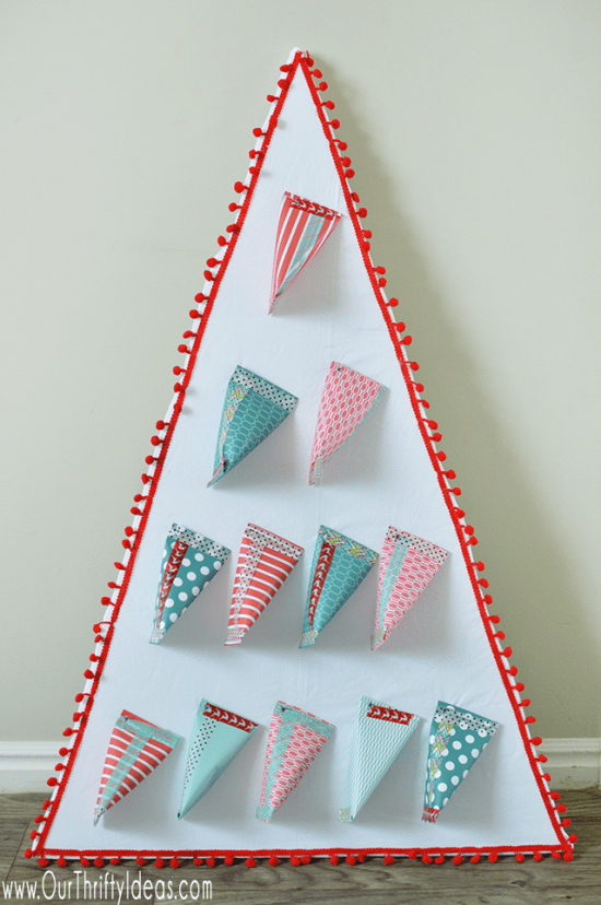 A step by step tutorial to create a beautiful and creative Christmas Tree advent calendar. Fill it with candy, holiday scriptures, random acts of kindness or Christmas traditions to do each day!