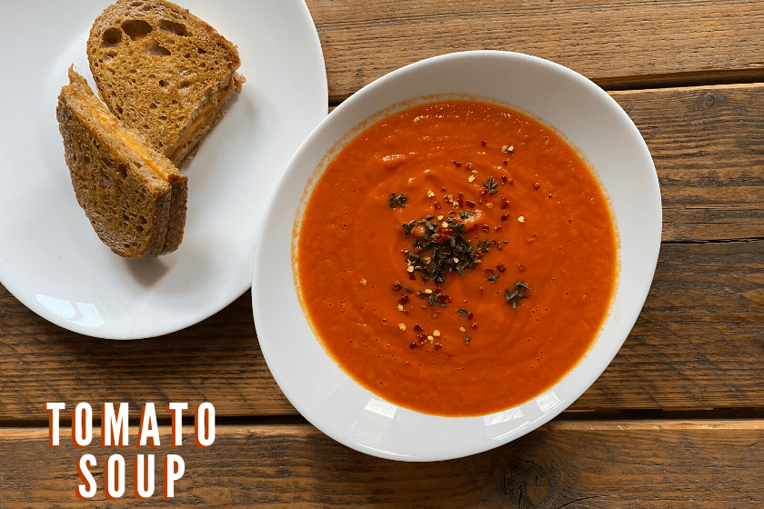 Vegan tomato soup with grilled cheese sandwich