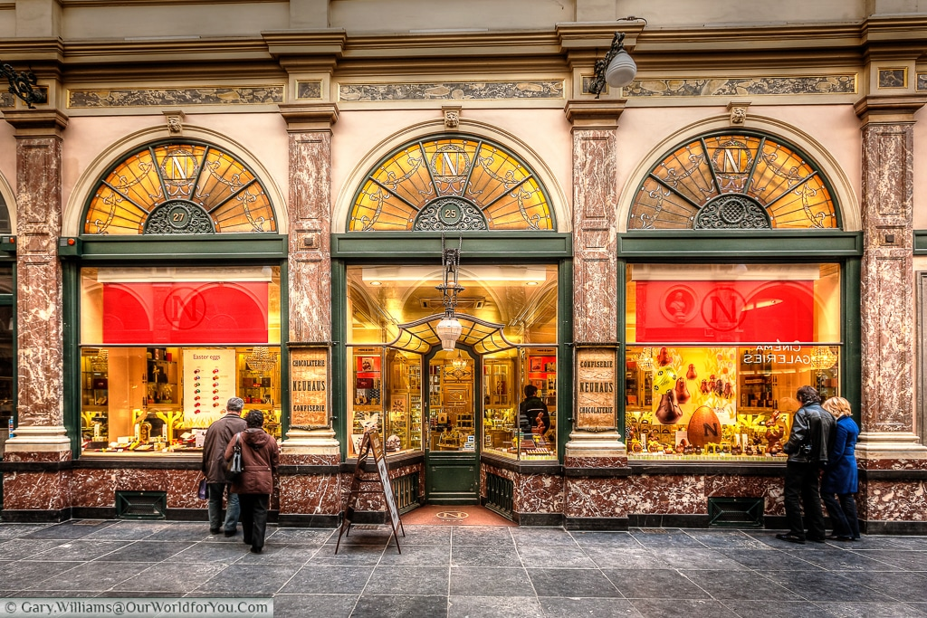 Passers by admire the work of chocolatiers in the Galeries Royales Saint-Hubert arcade in Brussels