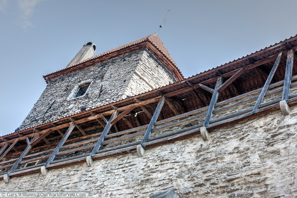 The high city walls that surround Tallinn old town.