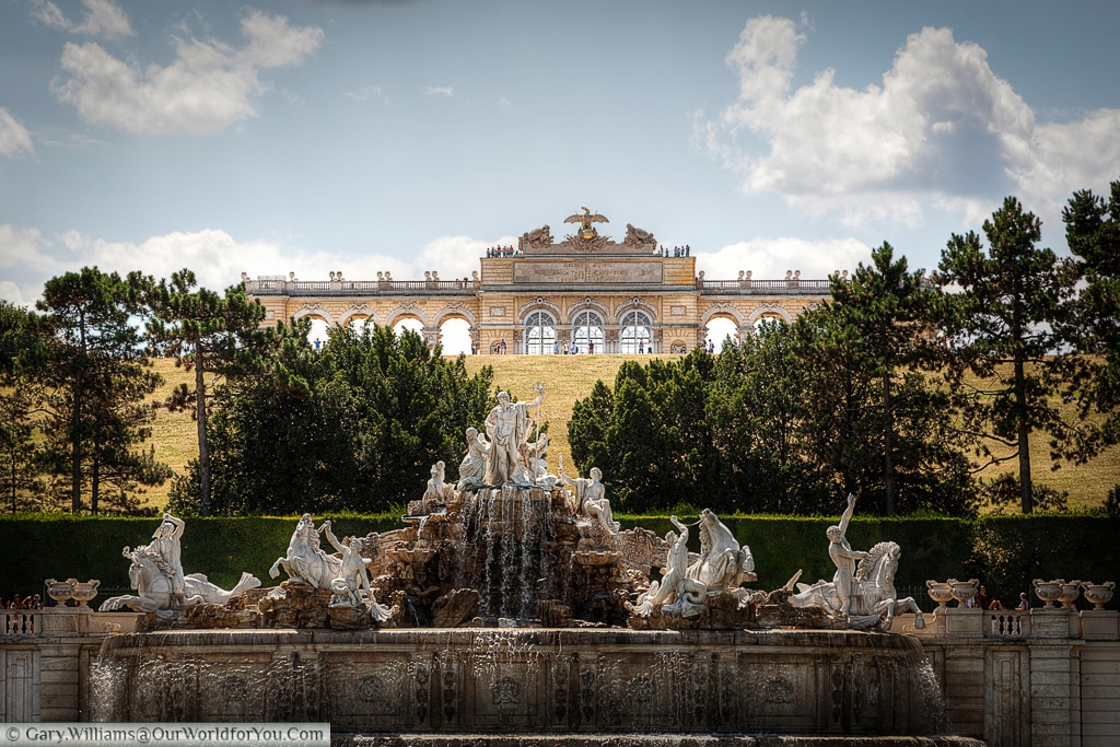 The Neptune fountain with the the Gloriette, in the background, on top of Schönbrunn hill.
