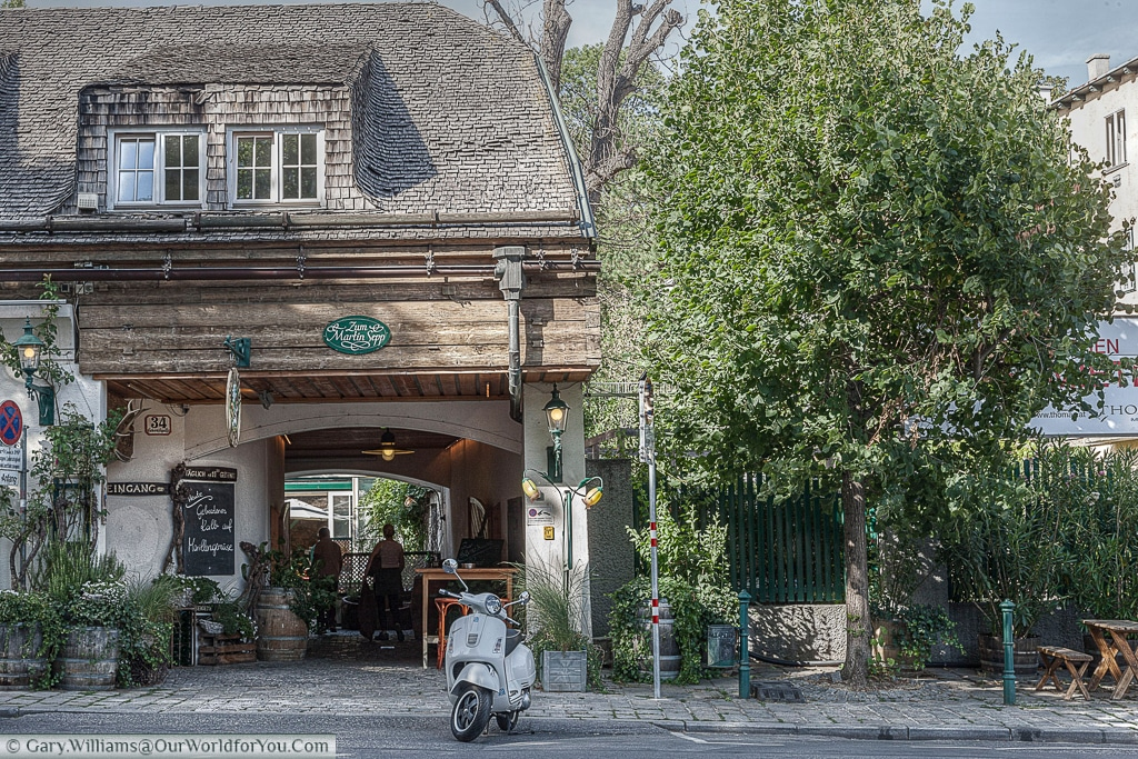 A moped outside a heuriger, or wine bar in the village of Grinzing, Vienna, Austria