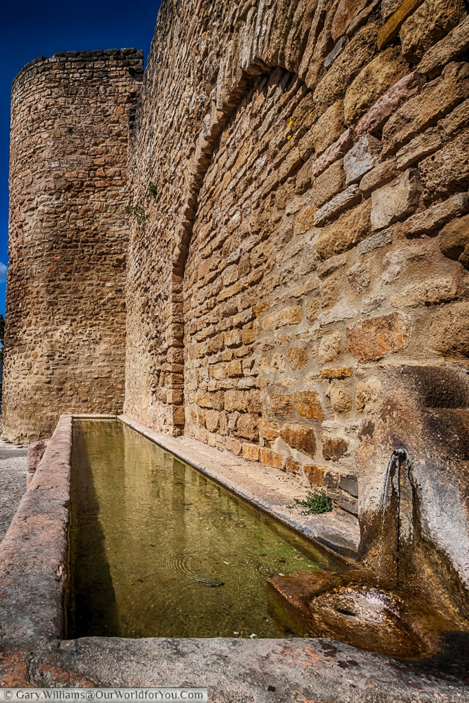 A water trough by the city walls, Ronda, Spain