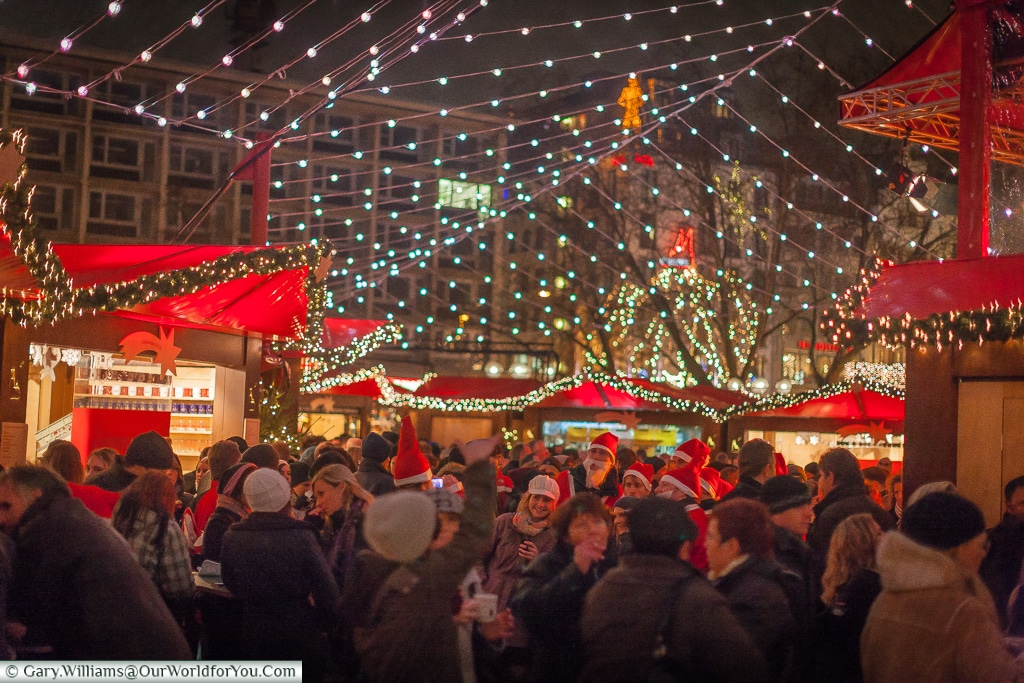 Crowds under the fairy lights at the Dom Christmas Market, Cologne, Germany