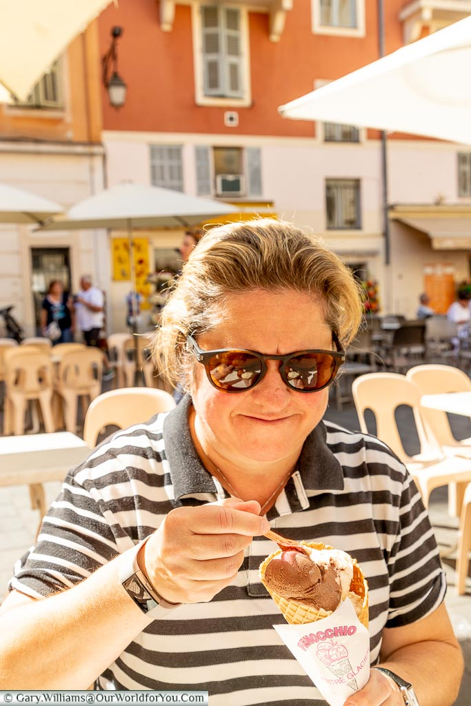 A smiling Janis, tucking into an ice-cream cone in Nice