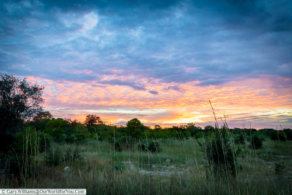 Pastel shades of a sunset over the bush in north west Zimbabwe.