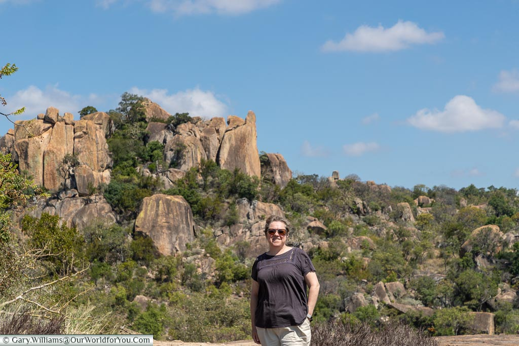A shot of Janis with a rock formation in the background at Matobo National Park.