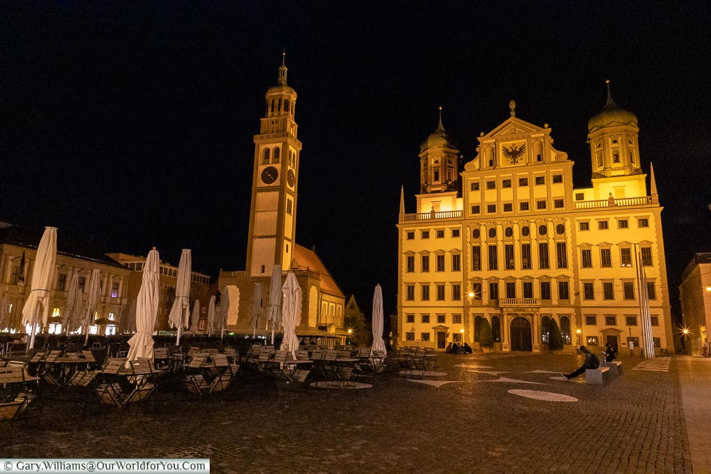 The Rathaus & Perlachturm from the Rathausplatz lit against the clear night sky.