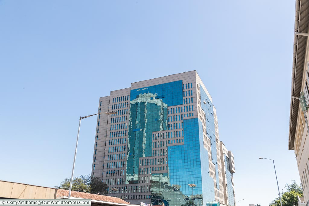 A stone & glass tower block  in downtown Harare.