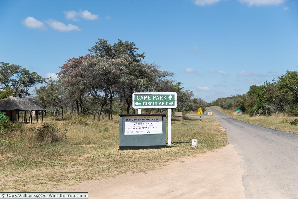 A sign within the entrance to the Matobo National Park with a route for the Game Drive and another for the Circular Drive.
