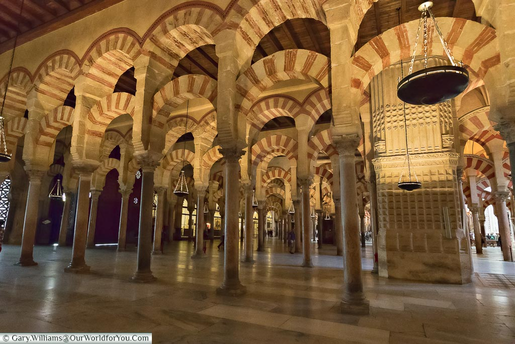 The decorative moorish arches of the Mosque–Cathedral of Cordoba.