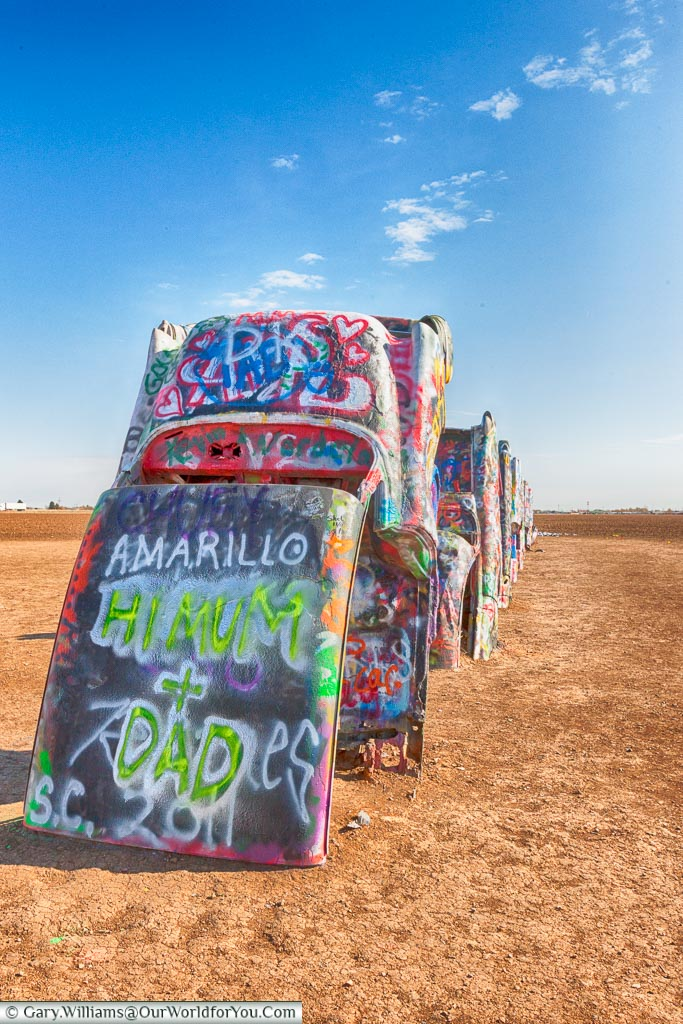 A postcard to loved ones at the Cadillac Ranch